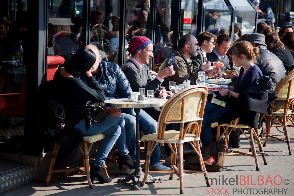 People in a pavement cafe.<br /> Paris, France.