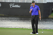 Justin Rose celebrates winning the World Golf Championship Cadillac Championship on the TPC Blue Monster Course at Doral Golf Resort And Spa on March 11, 2012 in Doral, Fla. ..©2012 Scott A. Miller..
