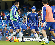Chelsea players warm up before kick off in the Barclays Premier League match between Chelsea and Everton at Stamford Bridge, London, England on 16 January 2016. Photo by Andy Walter.