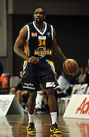 Akeem Wright moves up the court, in the NBL match, between the Otago Nuggets and Hawkes Bay, Lion Foundation Arena, Edgar Centre, Dunedin, Otago, New Zealand, Friday, May 24, 2013. Credit: Joe Allison / Allison Images.