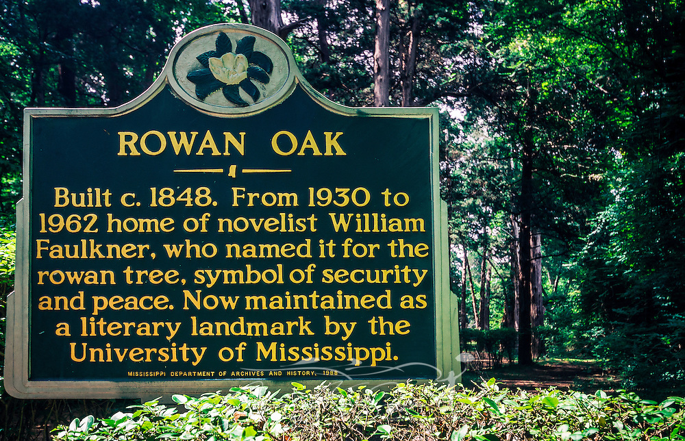 A historic marker is displayed outside Rowan Oak, the home of author William Faulkner, May 30, 2015, in Oxford, Mississippi.  (Photo by Carmen K. Sisson/Cloudybright)