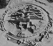 Excavation of one of the Royal Burial Mounds of A'ali, aerial photograph, in the Bahrain National Museum, designed by Krohn and Hartvig Rasmussen, inaugurated December 1988 by Amir Shaikh Isa Bin Salman Al-Khalifa, in Manama, Bahrain. This is a royal cemetery built for the Dilmun kings outside their capital Qal'at al-Bahrain, with 14 mounds built along a ceremonial route. The Bahrain National Museum houses cultural and archaeological collections covering 6000 years of history, with rooms entitled Burial Mounds, Dilmun, Tylos and Islam, Customs and Traditions, Traditional Trades and Crafts, and Documents and Manuscripts. Picture by Manuel Cohen
