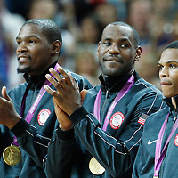 12 August 2012: USA Kevin Durant, LeBron James, and Russell Westbrook are seen with the gold medal following 107-100 Team USA victory over Team Spain, during the men's Gold Medal Game, at the North Greenwich Arena, in London, Great Britain.