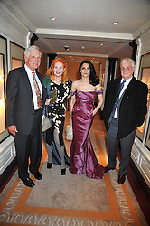 Left to right, TED TURNER, DAME VIVIENNE WESTWOOD, RENU MEHTA founder of Fortune Forum and GORDON SWIRE at the 3rd Fortune Forum Summit held at The Dorchester Hotel, Park Lane, London on 3rd March 2009.