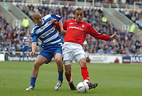 Photo. Leigh Quinnell.  Reading v Nottingham Forest Coca Cola championship. 16/04/2005. Readings James Harper and Nottingham Forests James Perch battle for the ball.
