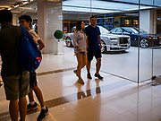 17 DECEMBER 2018 - BANGKOK, THAILAND: People walk by the Rolls-Royce showroom in Siam Paragon, an exclusive mall in central Bangkok. According to Credit Suisse Global Wealth Databook 2018, which surveyed 40 countries, Thailand has the highest rate of income inequality in the world. In 2016, Thailand was third, behind Russia and India. In 2016, the 1% richest Thais (about 500,000 people) owned 58.0% of the Thailand's wealth. In 2018, they controlled 66.9%. In Russia, those numbers went from 78% in 2016, down to 57.1% in 2018. The Thai government disagreed with the report and said the report didn't take government anti-poverty programs into account and that Thailand was held to an unfair standard because most of the other countries in the report are developed countries in the Organisation for Economic Co-operation and Development.    PHOTO BY JACK KURTZ