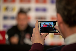 CARDIFF, WALES - Monday, November 18, 2019: A journalist take a photo of Wales' manager Ryan Giggs on an Apple iPhone  during a press conference at the Vale Resort ahead of the final UEFA Euro 2020 Qualifying Group E match against Hungary. (Pic by David Rawcliffe/Propaganda)