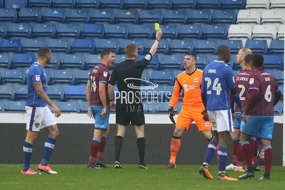 Yellow card for John Ruddy Oldham Goalkeeper during the EFL Sky Bet League 1 match between Oldham Athletic and Scunthorpe United at Boundary Park, Oldham, England on 28 October 2017. Photo by George Franks.