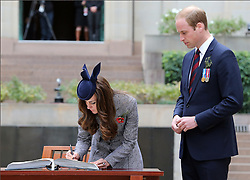 The Duke and Duchess of Cambridge sign the visitors book at the ANZAC Day March and Commemorative Service at the Australian War Memorial in Canberra, Australia, Friday, 25th April 2014. Picture by Stephen Lock / i-Images