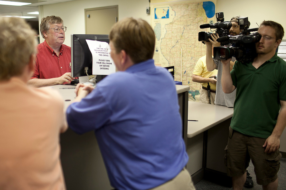 Cameramen from local news stations film Macon County Clerk Steve Bean as he prepares his first civil union license for Linda Schroeder and Nancy Ryherd in the Macon County Office Building just after 12 midnight Wednesday, June 1, 2011, in Decatur, Ill. (Stephen Haas)