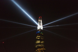 © Licensed to London News Pictures. 31/12/2014. London, UK. The Shard new year countdown light display is seen from Wapping in East London. Photo credit : Vickie Flores/LNP