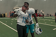 Miami Dolphins wide receivers Albert Wilson (15) and DeVante Parker (11) having fun after indoor practice during training camp at the Baptist Health Training Facility at Nova Southeastern University, Friday, August 2, 2019, in Davie, Fla. (Kim Hukari/Image of Sport)