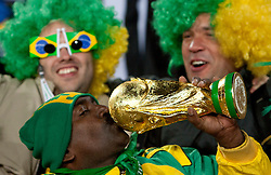 Brazil fans with a trophy during the 2010 FIFA World Cup South Africa Group G match between Brazil and North Korea at Ellis Park Stadium on June 15, 2010 in Johannesburg, South Africa. Brazil defeated Korea 2-1. (Photo by Vid Ponikvar / Sportida)
