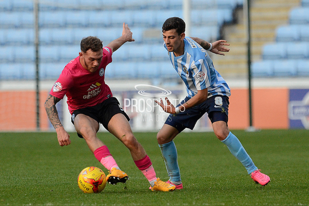 Peterborough United midfielder Jon Taylor gets away from Coventry City midfielder Ruben Lameiras during the Sky Bet League 1 match between Coventry City and Peterborough United at the Ricoh Arena, Coventry, England on 31 October 2015. Photo by Alan Franklin.