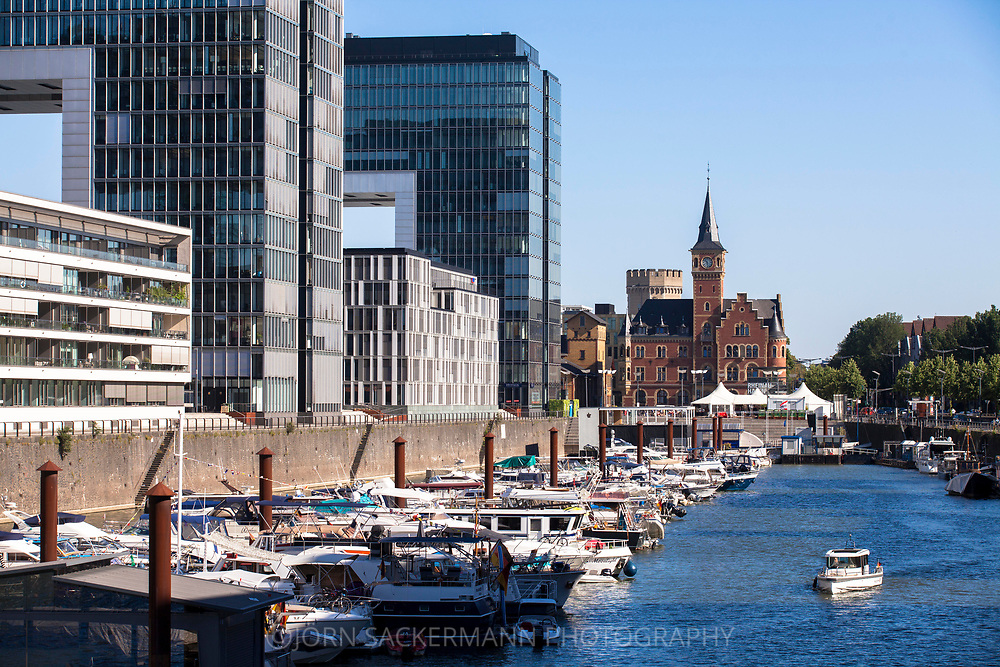 boats at the Rheinau harbour, in the background the old harbours masters office, on the left the crane houses, Cologne, Germany.<br /> <br /> Boote im Rheinauhafen, im Hintergrund das alte Hafenamt, links die Kranhaeuser, Koeln, Deutschland.