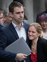 © Licensed to London News Pictures. 23/11/2016. London, UK. Family of murdered MP Jo Cox speak to reporters outside The Old Bailey after Thomas Mair was found guilty of her murder. Jo Cox's sister Kim Leadbetter hugs Jo's husband Brendan Cox. Defendant Thomas Mair chose not to give any evidence in his defence.  Mair shot and stabbed the 41-year-old Member of Parliament outside her constituency surgery in Birstall, near Leeds, Yorkshire on June 16 this year and has been given a whole life sentence. Photo credit: Peter Macdiarmid/LNP