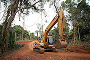 A digger on its way to a new Chinese hydro-electric dam being built drives through the forest. The Cardamom Mountains and surrounding forests is the largest and most pristine area of intact forest in SE Asia. Covering an area of 2.5 million acres it became one of the last strong holds of a retreating Khmer Rouge. Their presence helped preserve the forest as no-one dared to venture inside. But with the Khmer Rouge gone, it faces new dangers from poachers, loggers and illegal drug factories. In charge of protecting this vast forest are a handful of rangers who's job it is to track down and arrest those who are helping to destroy this delicate habitat.