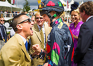 Frankie Dettori and Jemima Hannon at the Qatar Goodwood Festival, better known as Glorious Goodwood. Day Three.<br /> Picture date: Thursday July 30, 2015.<br /> Photograph by Christopher Ison &copy;<br /> 07544044177<br /> chris@christopherison.com<br /> www.christopherison.com