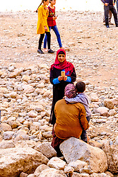 A woman taking a photograph with a phone in the Todra Gorge. Morocco<br /> <br /> (c) Andrew Wilson | Edinburgh Elite media