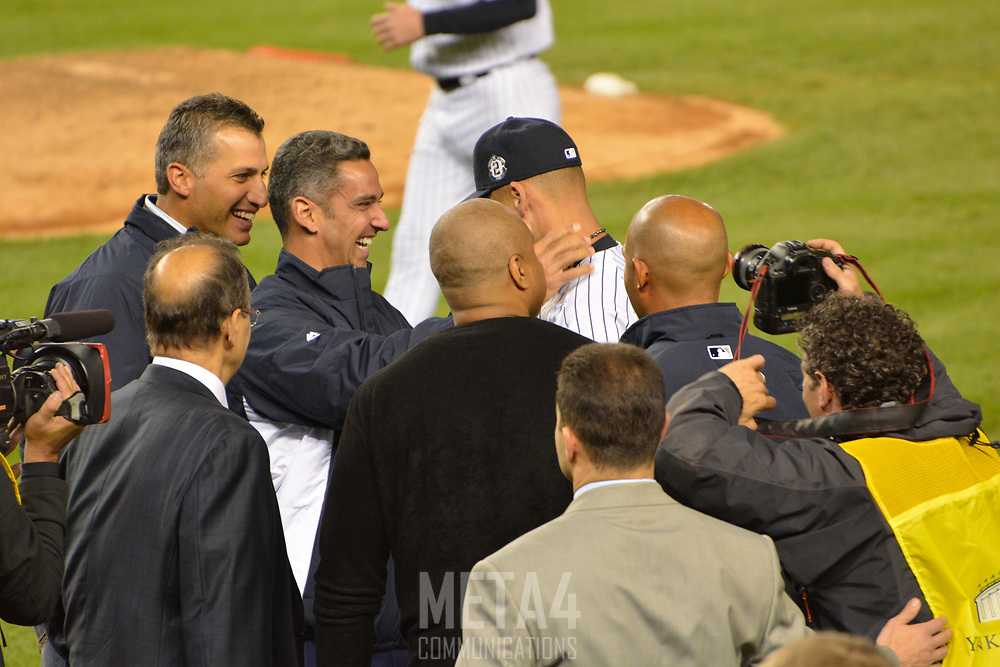 Derek Jeter is congratulated by World Series teammates (l.-r.) Andy Pettitte, Jorge Posada, Bernie Williams and Mariano Rivera. Manager Joe Torre (foreground l.) joins the action.