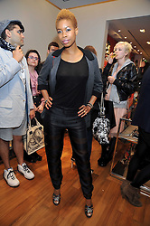 TOLULA ADEYEMI at a party in aid of the charity Best Buddies held at the Hogan store, 10 Sloane Street, London SW10 on 13th May 2009.