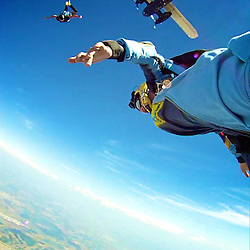 Skydive Photographer Pedro Pimentel exiting to a Atmonauti flight. Shot from the foot.