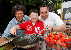 Repro Free: 30/06/2013 <br /> Pictured at the Gardenworld Kilquade inaugural Family Garden Party in aid of Down Syndrome Ireland and Lauralynn Children's Hospice are Gardenworld's Andrew King, Aidan Thomas (11) from Roscommon and celebrity Chef Nevin Maguire. Picture Andres Poveda