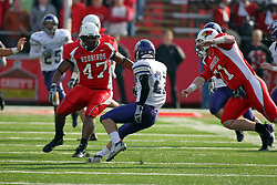 27 October 2007: Tim Jackson makes a quick move to avoid being tackled by Kedric Meredith and Joe Doyle. The Western Illinois Leathernecks beat up on the Illinois State Redbirds  27-14 at Hancock Stadium on the campus of Illinois State University in Normal Illinois.