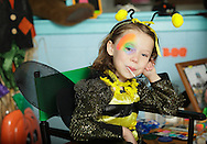 Middletown, New York  - A girl in a bumblebee costume sits while getting her face painted during the Middletown YMCA Family Fall Festival on Oct. 29, 2011.