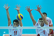 Poland's Mariusz Wlazly (left) and Piotr Nowakowski defend while volleyball final match between Brazil and Poland during the 2014 FIVB Volleyball World Championships at Spodek Hall in Katowice on September 21, 2014.<br /> <br /> Poland, Katowice, September 21, 2014<br /> <br /> For editorial use only. Any commercial or promotional use requires permission.<br /> <br /> Mandatory credit:<br /> Photo by &copy; Adam Nurkiewicz / Mediasport