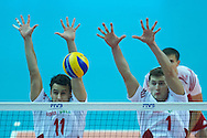 Poland's Mariusz Wlazly (left) and Piotr Nowakowski defend while volleyball final match between Brazil and Poland during the 2014 FIVB Volleyball World Championships at Spodek Hall in Katowice on September 21, 2014.<br /> <br /> Poland, Katowice, September 21, 2014<br /> <br /> For editorial use only. Any commercial or promotional use requires permission.<br /> <br /> Mandatory credit:<br /> Photo by © Adam Nurkiewicz / Mediasport