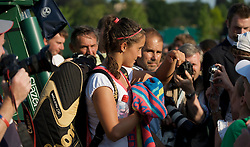 LONDON, ENGLAND - Tuesday, June 30, 2009: Laura Robson (GBR) surrounded by fans and photographers after her Girls' Singles 2nd Round match on day eight of the Wimbledon Lawn Tennis Championships at the All England Lawn Tennis and Croquet Club. (Pic by David Rawcliffe/Propaganda)