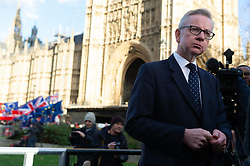 © Licensed to London News Pictures. 12/12/2018. London, UK. Secretary of State for Environment, Food and Rural Affairs Michael Gove arrives on College Green to give interviews. The Prime Minister faces a vote of no confidence from her own party this evening. Photo credit: Ray Tang/LNP