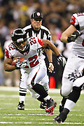 NEW ORLEANS, LA - DECEMBER 26:   Jacquizz Rodgers #22 of the Atlanta Falcons runs the ball against the New Orleans Saints at Mercedes-Benz Superdome on December 26, 2011 in New Orleans, Louisiana.  The Saints defeated the Falcons 45-16.  (Photo by Wesley Hitt/Getty Images) *** Local Caption *** Jacquizz Rodgers