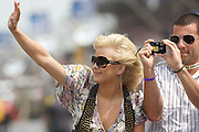 Singer and professional dancer Julianne Hough waves to the crowd before the 92nd running of the Indianapolis 500 on May 25, 2008. Photo by Michael Hickey