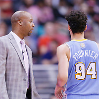 15 April 2014: Denver Nuggets head coach Brian Shaw talks to Denver Nuggets guard Evan Fournier (94) during the Los Angeles Clippers 117-105 victory over the Denver Nuggets at the Staples Center, Los Angeles, California, USA.