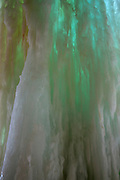 LaSalle Canyon Falls, a 20-foot (6-meter) waterfall in Starved Rock State Park, Illinois, freezes in winter. Viewed from behind, the ice thins as the icefall thaws and can become almost translucent, forming dramatic green and blue colors as the ice of varying thickness refracts sunlight to different degrees.