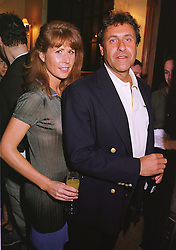 The HON.AURELIA CECIL and MR CHRISTOPHER LEIGH-PEMBERTON,  at a party in London on 1st June 1999.MSP 29