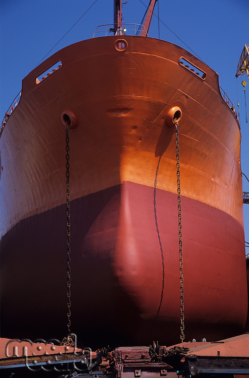Large Bronze and red ship in Dry dock