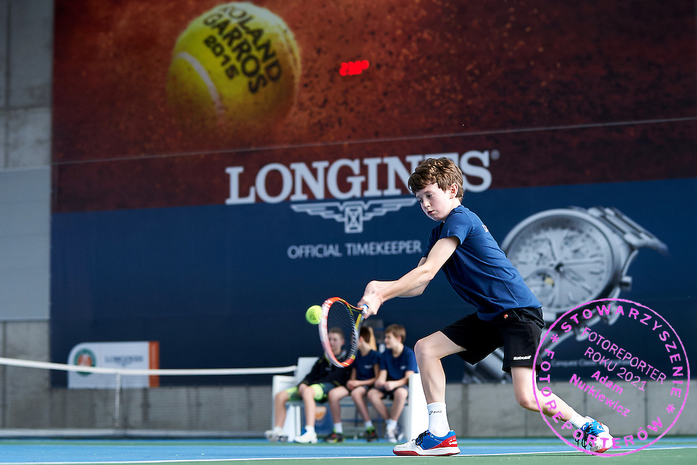 Marcel Kamrowski from Poland under-14 tennis player competes during the Longines Future Tennis Aces 2015 at Tuan Tennis Club in Jozefoslaw near Warsaw on April 11, 2015.<br /> <br /> Poland, Warsaw, April 11, 2015<br /> <br /> Picture also available in RAW (NEF) or TIFF format on special request.<br /> <br /> For editorial use only. Any commercial or promotional use requires permission.<br /> <br /> Mandatory credit:<br /> Photo by &copy; Adam Nurkiewicz / Mediasport