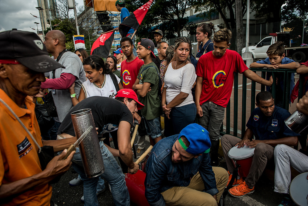 CARACAS, VENEZUELA - JULY 27, 2017: Government workers play music as they celebrate the final campaign rally for candidates for the election of the new constituent assembly, that will be held on July 30th. They marched and danced in the streets, as President Maduro and other socialist leaders addressed the large crowd. Opponents of the government criticize President Maduro for calling for this election - saying the new assembly is a power grab, and will be a puppet of the President - the only candidates on the ballot are government loyalists. Critics also fear the new assembly will re-write the constitution and wipe out the democratically elected and opposition controlled congress. There have been widespread reports of voter intimidation, and of the government threatening state workers and citizens that receive government benefits like subsidized food - who report the government telling them they are obligated to vote, and if they don't, they will lose their jobs and benefits. Thousands have taken to the streets to protest the election in the days leading up to the July 30th vote.  PHOTO: Meridith Kohut for The New York Times