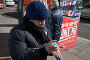 On the day that the UK Government's Chief Scientific Advisor, Sir Patrick Vallance said that the Coronavirus Covid-19 outbreak was now spreading person to person in the UK, a Londoner just emerged from the Central Line, squeezes some hand gel onto his hands outside Green Park underground station on Piccadilly, on 6th March 2020, in London, England.