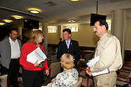 MAY 9, 2011 - MINEOLA, NY: Claudia Borecky (in red jacket with black tie belt), President of North and Central Merrick Civic Association at Redistricting hearing at Nassau County Executive and Legislative Building at 1550 Franklin Avenue, Mineola, New York, USA on May 9, 2011. photo copyright © 2011 Ann Parry, All rights reserved, http://annparryphotography.com