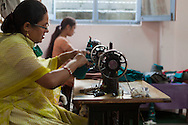 Nepali women operate sewing machines at Womens Skills Development Project in Pokhara, Nepal. The WSDP was set up in 1975 as a non-profit, fair trade organization to help disadvantaged women in Nepal.