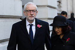 © Licensed to London News Pictures. 10/11/2019. London, UK. Leader of the Labour Party, Jeremy Corbyn walks through Downing Street with his wife Laura Alvarez to attend the Remembrance Sunday Ceremony at the Cenotaph in Whitehall. Remembrance Sunday events are held across the country today as the UK remembers and honours those who have sacrificed themselves in two world wars and other conflicts. Photo credit: Vickie Flores/LNP