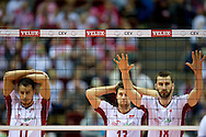 (L-R) Fabian Drzyzga and Michal Kubiak and Marcin Mozdzonek all from Poland during the 2013 CEV VELUX Volleyball European Championship match between Poland v Slovakia at Ergo Arena in Gdansk on September 22, 2013.<br /> <br /> Poland, Gdansk, September 22, 2013<br /> <br /> Picture also available in RAW (NEF) or TIFF format on special request.<br /> <br /> For editorial use only. Any commercial or promotional use requires permission.<br /> <br /> Mandatory credit:<br /> Photo by © Adam Nurkiewicz / Mediasport