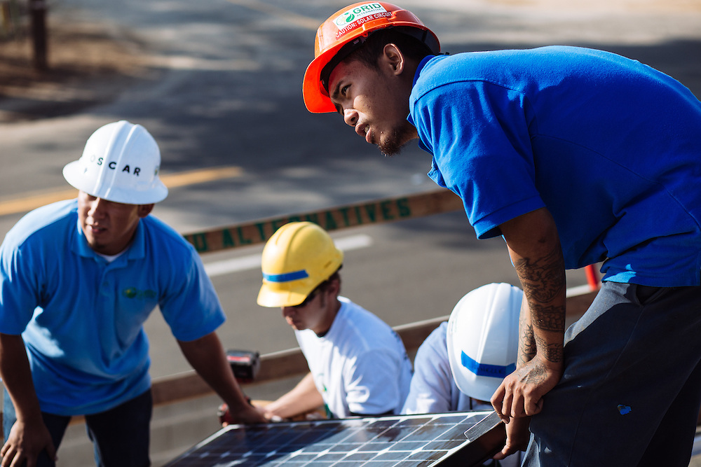 Denny Sysaknoi, 21, works on the roof of a home in Madera, California during a Solarthon event with Grid Alternatives. Sysaknoi did a six-month internship with Grid Alternatives before getting a full-time job with Lifestyle Solar. Sysaknoi was raised by his grandmother in a tough neighborhood in Fremont and now has a child of his own.