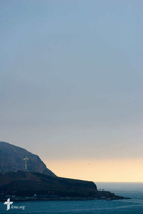 A lit cross punctuates the landscape on Monday, Nov. 6, 2017, in Lima, Peru.  LCMS Communications/Erik M. Lunsford