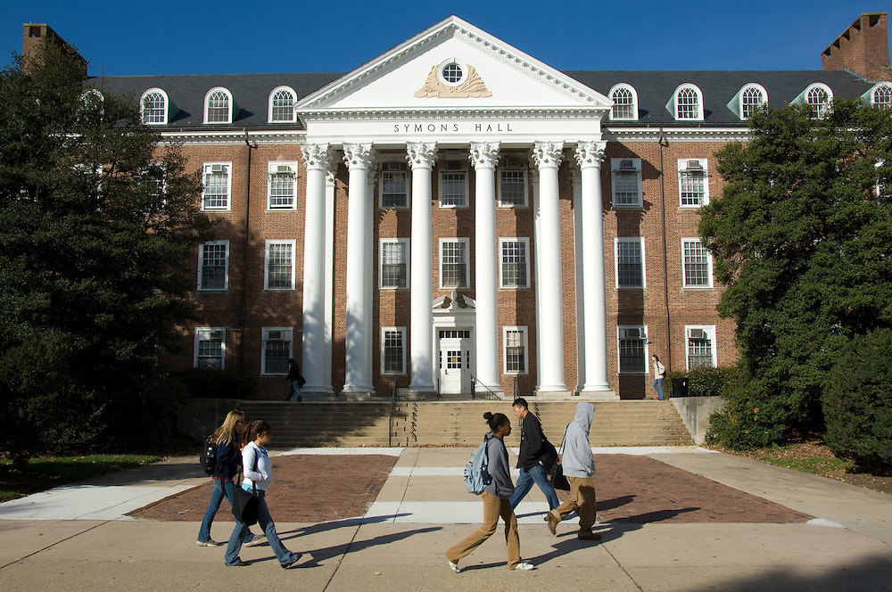 Students walking on campus in front of Symons Hall, University of Maryland