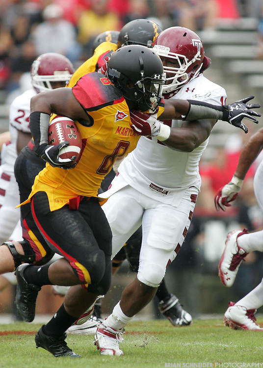 September 24, 2011; College Park, MD, USA; Temple Owls defensive end John Youboty (11) tackles Maryland Terrapins running back Davin Meggett (8) during first half at Byrd Stadium in College Park, Maryland. Brian Schneider-www.ebrianschneider.com